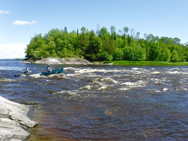 Tessa (bow) and Chelsea (stern) on of our first sets of rapids along the Rainy River.