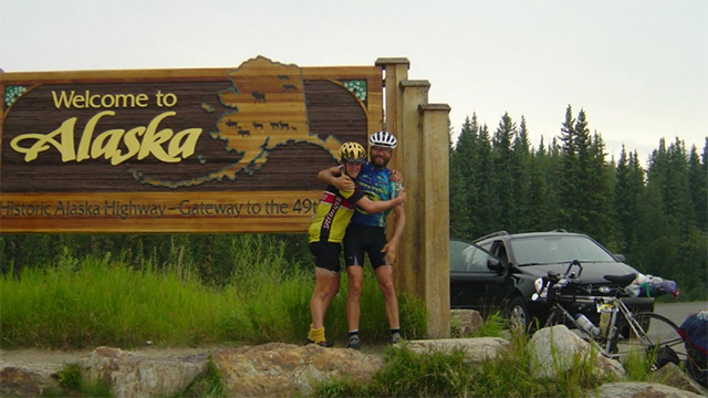 A friend and Dan Chew on a cycle trip through Alaska. Photo: Courtesy of You Caring