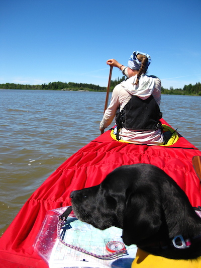 Whitney and Avery on Lake Winnipeg with canoe covers on.