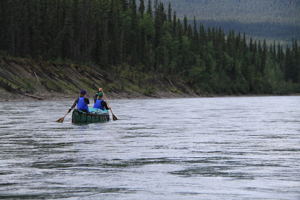 Kate Lauth (stern) and Jen Crozier (bow) paddle the Stikine River in British Columbia.