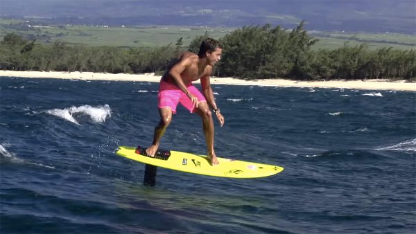 Kai Lenny riding open ocean swells on hydrofoil