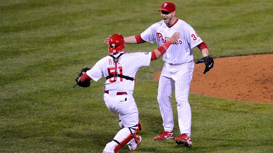 Roy Halladay #34 of the Philadelphia Phillies celebrates with Carlos Ruiz #51 after throwing a no hitter against the Cincinnati Reds on October 6, 2010 during Game 1 of the NLDS at Citizens Bank Park in Philadelphia, Pennsylvania. The Phillies defeated the Reds 4-0. (Photo by: Rob Tringali/SportsChrome/Getty Images)