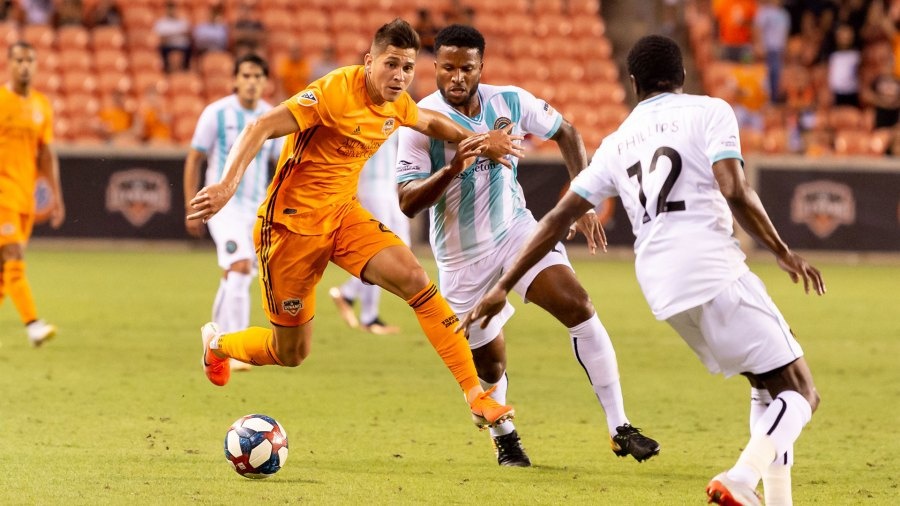 Lamar Hunt US Open Cup Austin FC vs Houston Dynamo round 4, Houston, USA - 11 Jun 2019 Houston Dynamo forward Ronaldo Pena (21) and Austin Bold FC defender Jermaine Taylor (4) battle mid pitch during a match between Austin FC and Houston Dynamo at BBVA Stadium in Houston, Texas. Houston Dynamo win 3-2. Maria Lysaker / CSM 11 Jun 2019