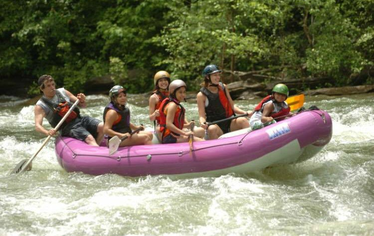 Lewis takes his family rafting on the Ocoee River in Tennessee.