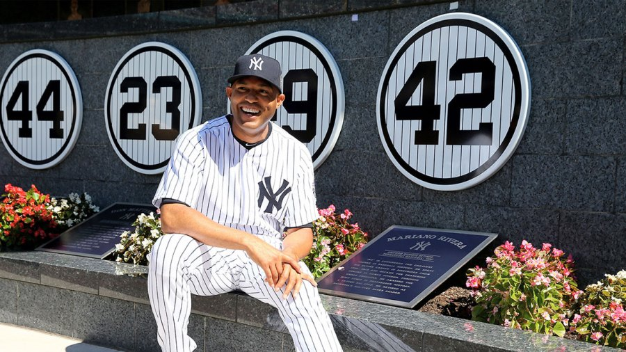 Mariano Rivera #42 of the New York Yankees poses next to his retired number in Monument Park before the interleague game against the San Francisco Giants on September 22, 2013 at Yankee Stadium in the Bronx borough of New York City. Rivera was honored by the New York Yankees today with Mariano Rivera Day. (Photo by Elsa/Getty Images)