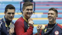 Rio 2016 Olympic Games, Swimming, Olympic Aquatics Stadium, Brazil - 12Aug 2016 France's silver medal winner Florent Manaudou, left, looks to United States' bronze medal winner Nathan Adrian and United States' gold medal winner Anthony Ervin, right, in the men's 50-meter freestyle medals ceremony during the swimming competitions at the 2016 Summer Olympics, Friday, Aug. 12, 2016, in Rio de Janeiro, Brazil. 13 Aug 2016 Image ID: 5827724ck Featured in: Rio 2016 Olympic Games, Swimming, Olympic Aquatics Stadium, Brazil - 12Aug 2016 Photo Credit: Marcos De Paula/Agif/Shutterstock