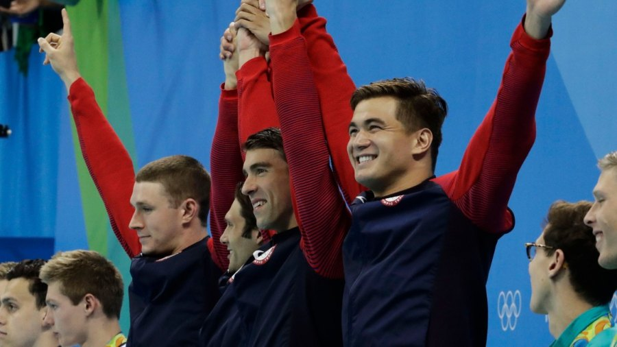 Rio 2016 Olympic Games, Swimming, Olympic Aquatics Stadium, Brazil - 13 Aug 2016 From left to right, United States' Ryan Murphy, Cody Miller, Michael Phelps and Nathan Adrian celebrate winning gold during the medal ceremony for the men's 4 x 100-meter medley relay final during the swimming competitions at the 2016 Summer Olympics, in Rio de Janeiro, Brazil 13 Aug 2016 Image ID: 5828623y Featured in: Rio 2016 Olympic Games, Swimming, Olympic Aquatics Stadium, Brazil - 13 Aug 2016 Photo Credit: Dmitri Lovetsky/AP/Shutterstock