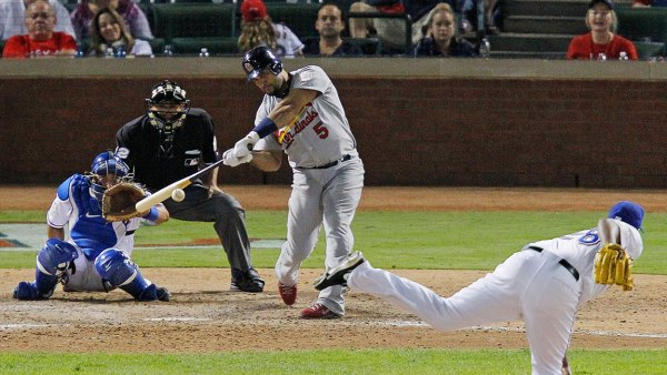 St. Louis Cardinals' Albert Pujols (5) hits a solo home run in the ninth inning off of Texas Rangers relief pitcher Darren Oliver, his third home run in Game 3 of the World Series at Rangers Ballpark in Arlington on Saturday, October 22, 2011, in Arlington, Texas. The Cardinals took a 2-1 series lead with a 16-7 victory. (Rodger Mallison/Fort Worth Star-Telegram/MCT via Getty Images)