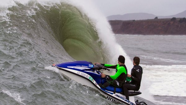 photographing big-wave surfing