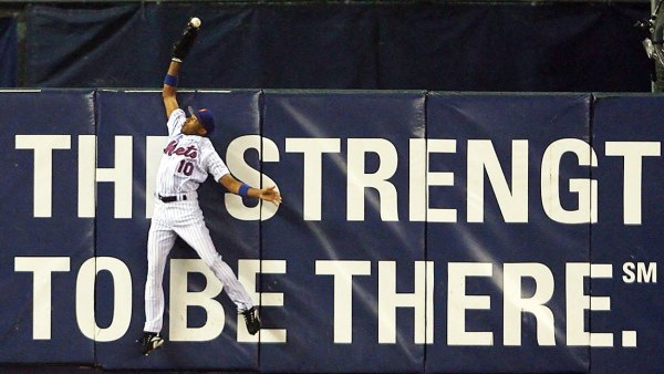 Endy Chavez #10 of the New York Mets catches a ball hit in the sixth inning hit by Scott Rolen #27 of the St. Louis Cardinals during game seven of the NLCS at Shea Stadium on October 19, 2006 in the Flushing neighborhood of the Queens borough of New York City. (Photo by Nick Laham/Getty Images)