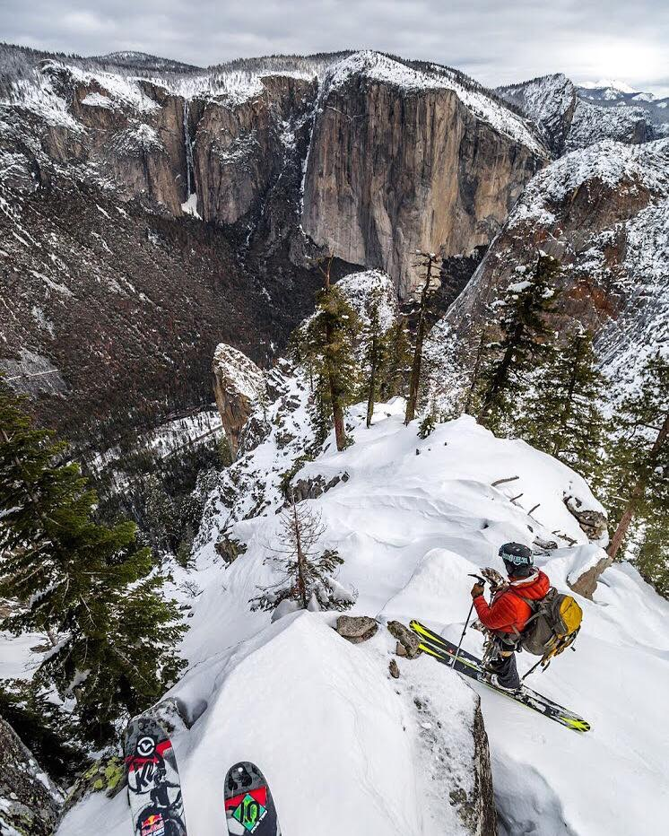 The tips of Eric Rasmussen's skis and Jason Torlano backcountry skiing in Yosemite Valley. The 3,000 foot face of El Capitan is in the distance. Photo courtesy of Eric Rasmussen