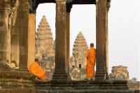 Angkor Wat, Buddhist monks standing amongst ruins