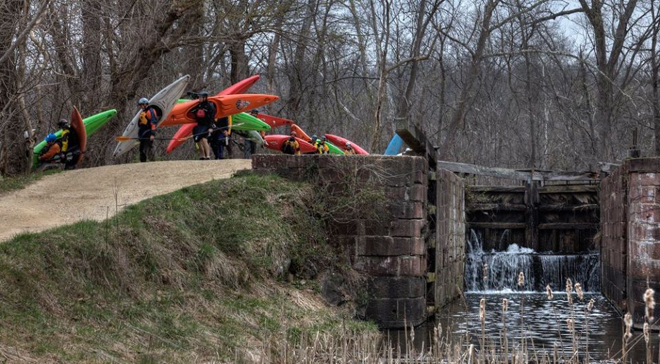 Long boats hiking down the C&O Canal to launch on the Potomac. Image courtesy of Calleva's Liquid Adventures Kayak School