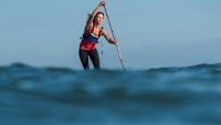 Shae Foudy standup paddleboarding off the Southern California coast.