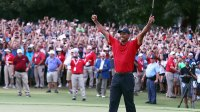 Tiger Woods of the United States celebrates making a par on the 18th green to win the TOUR Championship at East Lake Golf Club on September 23, 2018 in Atlanta, Georgia. (Photo by Tim Bradbury/Getty Images)