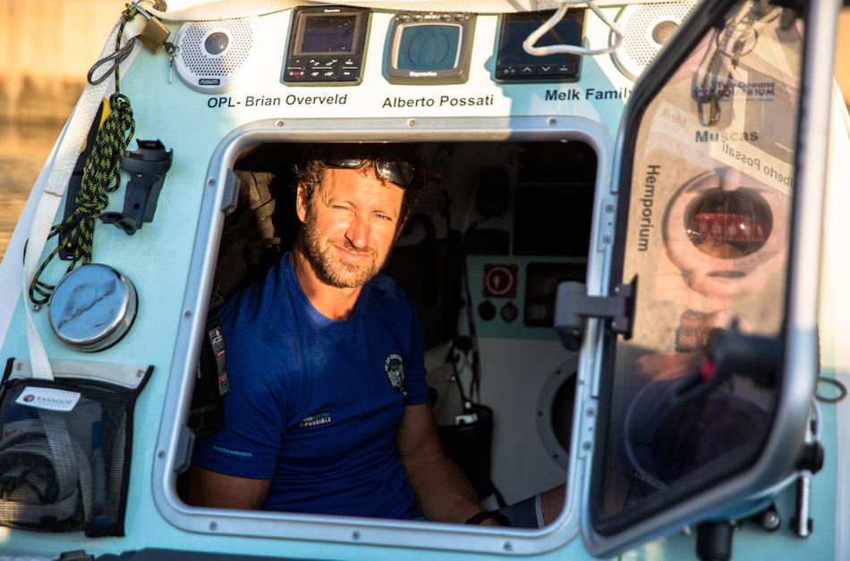 Chris Bertish in his home on the water. This is where he sleeps. Photo: #TheSUPCrossing