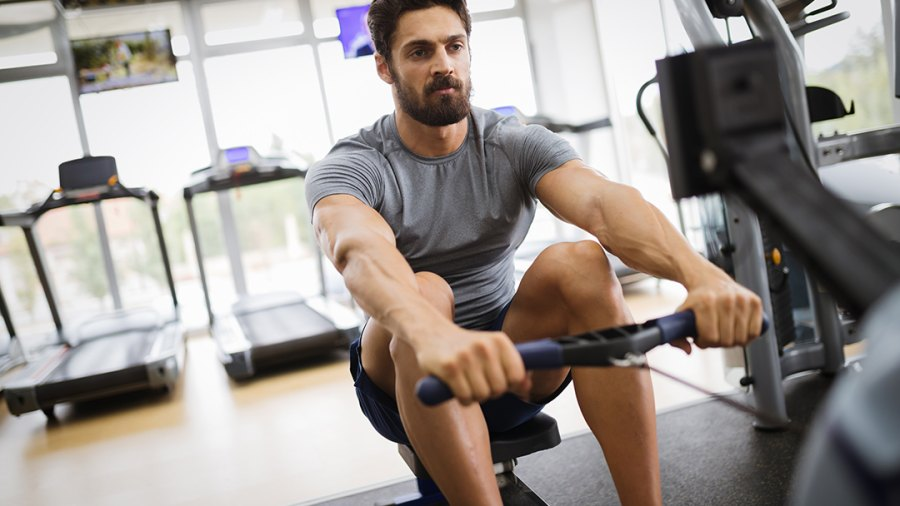 Rowing Workouts: Man using Rowing Machine