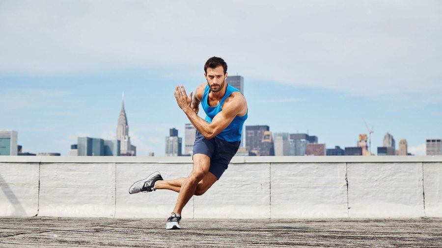 Man doing lateral skaters on rooftop in NYC