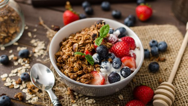 yogurt with blueberries, strawberries and granola