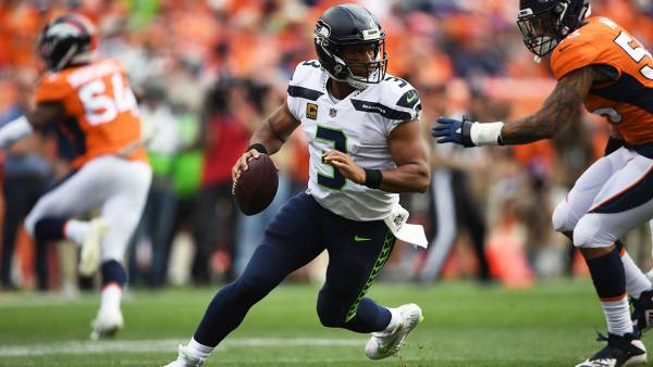 Seattle Seahawks quarterback Russell Wilson (3) looks downfield while under preassure during the second quarter on Sunday, September 9 at Broncos Stadium at Mile High. The Denver Broncos hosted the Seattle Seahawks in the first game of the season. (Photo by Joe Amon/The Denver Post via Getty Images)