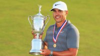 Brooks Koepka of the United States celebrates with the U.S. Open Championship trophy after winning the 2018 U.S. Open at Shinnecock Hills Golf Club on June 17, 2018 in Southampton, New York.
