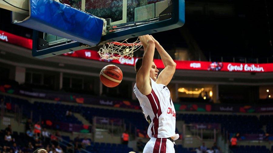 Basketball Europeans, Istanbul, Turkey - 04 Sep 2017 Latvia's Kristaps Porzingis dunks the ball as Britain's players look on during their Eurobasket European Basketball Championship Group D match in Istanbul