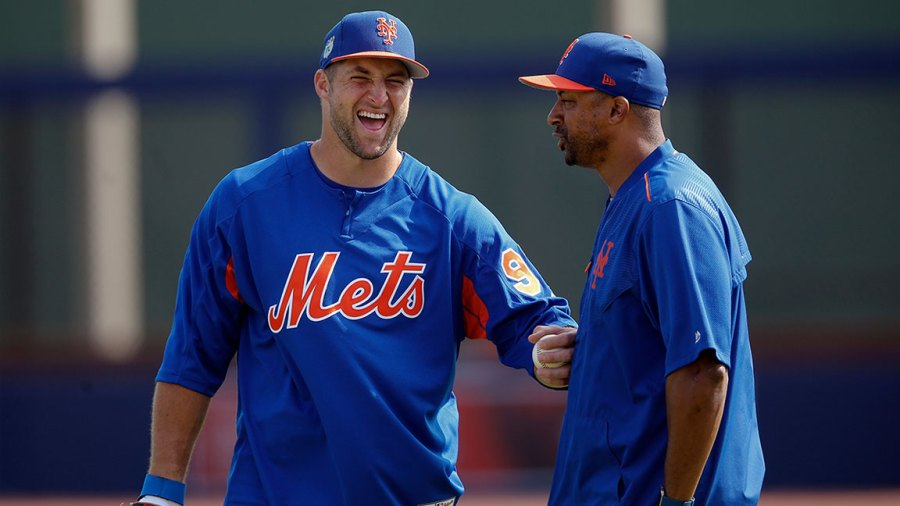New York Mets v Houston Astros, Spring training baseball game, West Palm Beach, USA - 14 Mar 2017 Tim Tebow, Tom Goodwin New York Mets outfielder Tim Tebow shares a laugh with first base coach Tom Goodwin (26) before a spring training baseball game against the Houston Astros, in West Palm Beach, Fla 14 Mar 2017