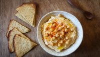 Bowl of Hummus and flat bread on wood