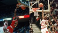 L: UNDATED: Michael Jordan #23 jumps and dunks circa the 1990's during a game. (Photo by Focus on Sport/Getty Images), R: CHICAGO, UNITED STATES: Michael Jordan (R) of the Chicago Bulls flies in for the dunk while Karl Malone (L) of the Utah Jazz watches 10 June during game four of the NBA Finals at the United Center in Chicago, IL. Jordan finished with 34 points as the Bulls beat the Jazz 86-82 to lead the best-of-seven series 3-1. AFP PHOTO/Jeff HAYNES (Photo credit should read JEFF HAYNES/AFP/Getty Images)