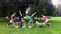 Group AcroYoga pose during a jam at Cheesman Park, Denver.
