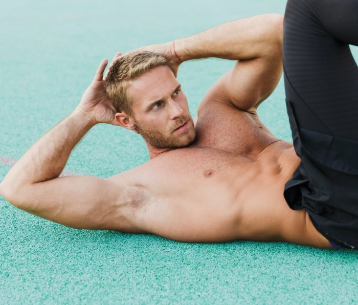 Man doing bicycle crunches outdoors