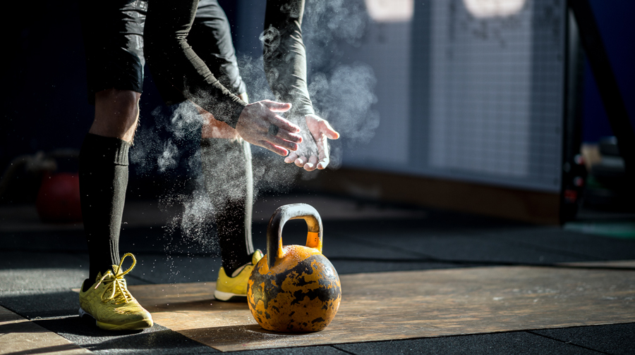 Gym fitness workout: Man ready to exercise with kettle bell