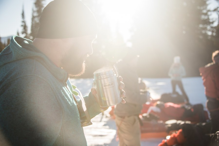 Man drinking out of Thermos outdoors