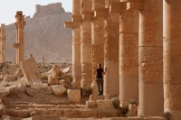 Syria, Palmyra. A tourist stands amongst the ancient ruins of Queen Zenobia's city at Palmyra.(MR)