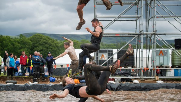Competitors drop into icy waters as part of Tough Mudder obstacle