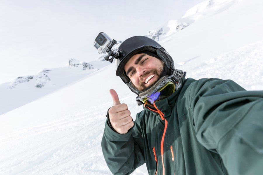 Skier with camera mounted on helmet
