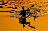 ATHENS - AUGUST 26: A kayaker warms up before the men's K-1 500 metre semifinal on August 26, 2004 during the Athens 2004 Summer Olympic Games at the Schinias Olympic Rowing and Canoeing Centre in Athens, Greece.