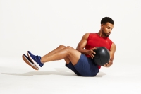 Man doing Russian Twist with medicine ball