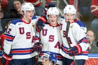 BUFFALO, NY - JANUARY 05: Trent Frederic #34 of United States (center) celebrates his hat trick goal with Dylan Samberg #12 and Riley Tufte #27 during the second period of play against the Czech Republic in the IIHF World Junior Championships Bronze Medal game at KeyBank Center on January 5, 2018 in Buffalo, New York. Team USA held a 7-0 after the second period.