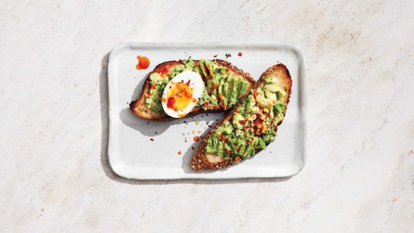 Avocado toast with egg and hot sauce