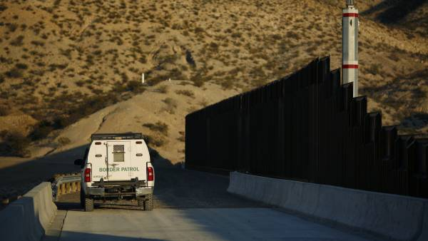 A U.S. Border Patrol vehicle sits parked next to a border fence that separates the U.S. and Mexico in Sunland Park, New Mexico, U.S., on Wednesday, Nov. 8, 2017. If the renegotiation of the North American Free Trade Agreement encounters trouble, it could impact other areas of cooperation with the U.S. such as security and immigration, according to Mexican Foreign Minister Luis Videgaray.