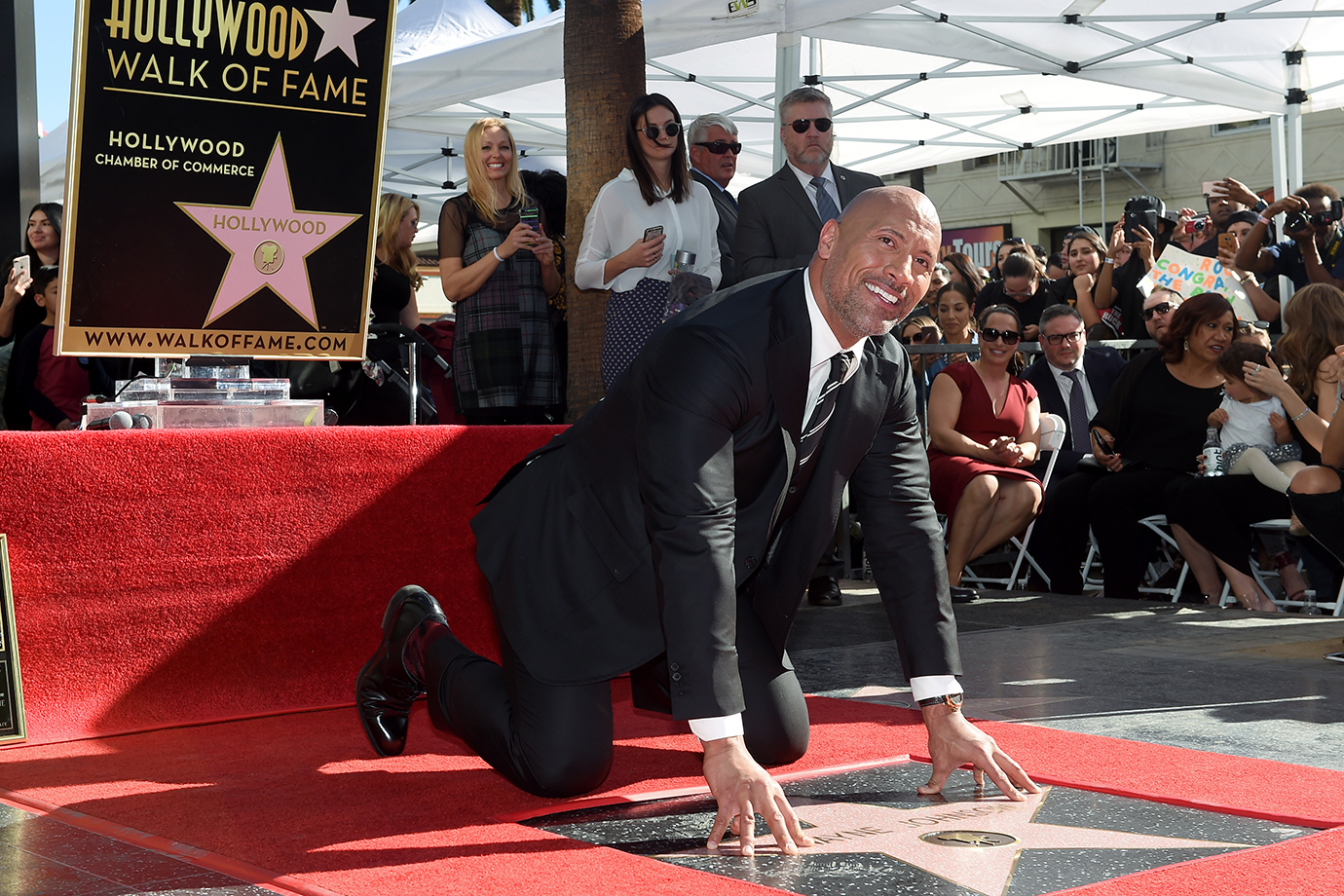 HOLLYWOOD, CA - DECEMBER 13: Actor Dwayne Johnson is honored with star on the Hollywood Walk of Fame on December 13, 2017 in Hollywood, California.