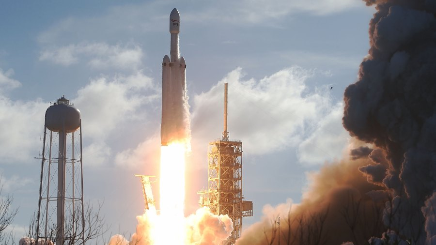CAPE CANAVERAL, FL - FEBRUARY 06: The SpaceX Falcon Heavy rocket lifts off from launch pad 39A at Kennedy Space Center on February 6, 2018 in Cape Canaveral, Florida. The rocket is the most powerful rocket in the world and is carrying a Tesla Roadster into orbit.