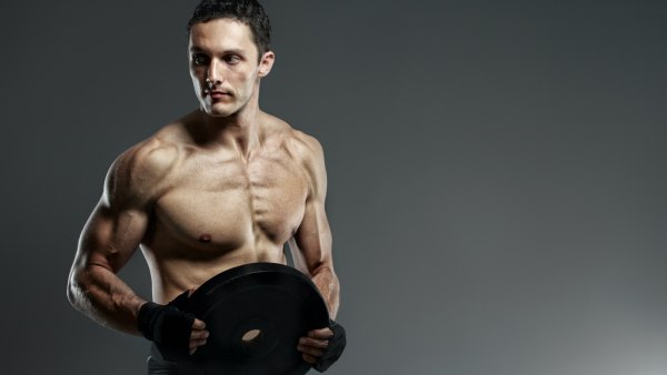 Fit man holding weight plate