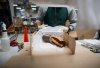 A worker packages boots for shipping at the L.L. Bean Inc.