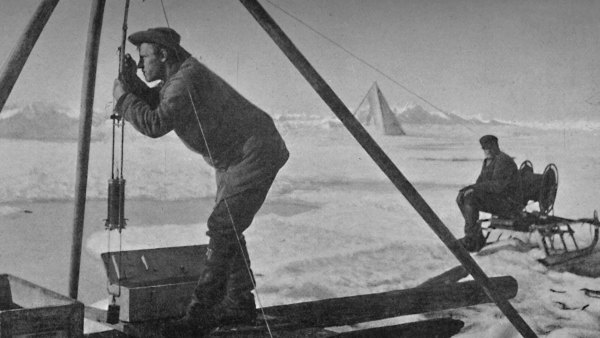Reading the Temperature with a Lens. 12 July, 1894', 1894 (1897). From Farthest North, Vol. 1 by Fridtjof Nansen. [Archibald Constable and Company, London, 1897].