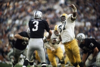 MIAMI - JANUARY 14: Oakland Raiders quarterback Daryle Lamonica #3 passes to a receiver as a Green Bay Packers player runs in for the tackle during Superbowl II at the Orange Bowl on January 14, 1968 in Miami, Florida. The Packers defeated the Raiders 33-14.