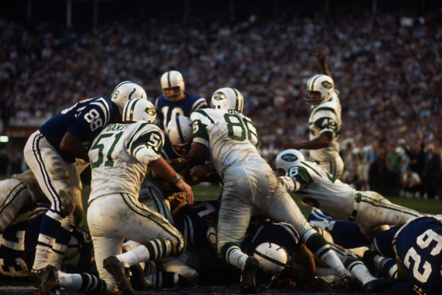 MIAMI - JANUARY 12: Tom Mackey of the Baltimore Colts is held at the line by the Now York Jets' defensive line during Super Bowl III at the Orange Bowl on January 12, 1969 in Miami, Florida. The Jets defeated the Colts 16-7.