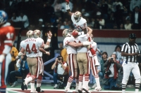 NEW ORLEANS, LA - JANUARY 28: Jerry Rice #80 of the San Francisco 49ers celebrates with teammates after he scored a touchdown against the Denver Broncos during Super Bowl XXIV on January 28, 1990 at the Super Dome in New Orleans, LA. The 49ers won the Super Bowl 55-10.