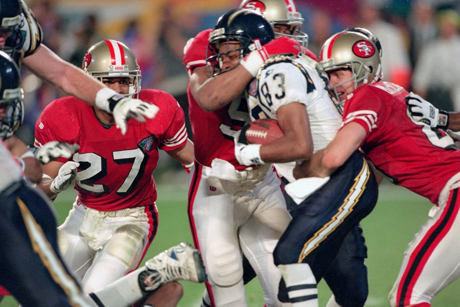 MIAMI, FL- JANUARY 29: Andre Coleman #83 of the San Diego Chargers gets tackled returning a kickoff against the San Francisco 49ers during Super Bowl XXIX on January 29, 1995 at Joe Robbie Stadium in Miami, Florida. The Niners won the Super Bowl 49-26.